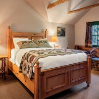 Lodge Room #4 is a quaint room with a rustic feel