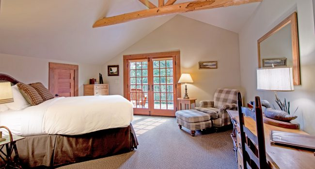 Lodge Room #5 has an open feel with vaulted ceilings and french doors to the private balcony